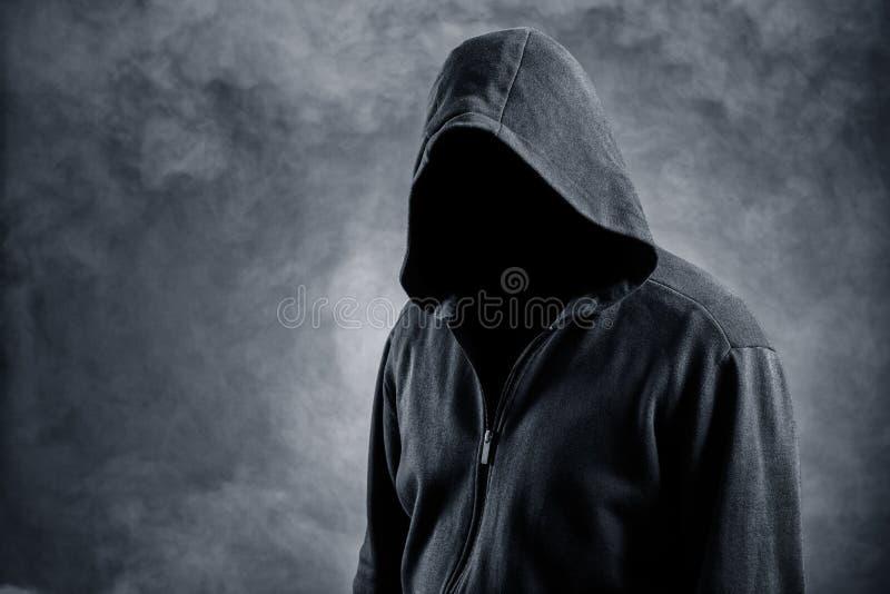 Αόρατο άτομο στην κουκούλα στοκ εικόνα