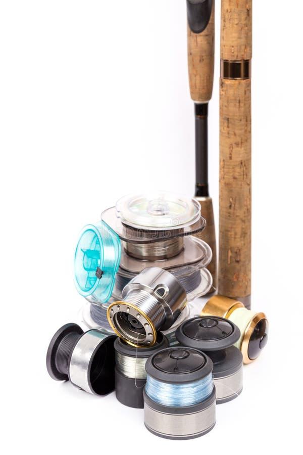 Αλιεύοντας ράβδοι, στροφία με τη γραμμή για τα εξέλικτρα στοκ εικόνες