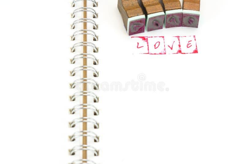 Αλφάβητο γραμματοσήμων με τους φραγμούς ΑΓΑΠΗΣ και σφράγισης λέξης στοκ φωτογραφίες