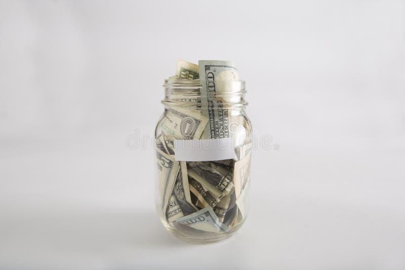 Βάζο του Mason με τα χρήματα με την κενή ετικέτα στοκ φωτογραφία με δικαίωμα ελεύθερης χρήσης
