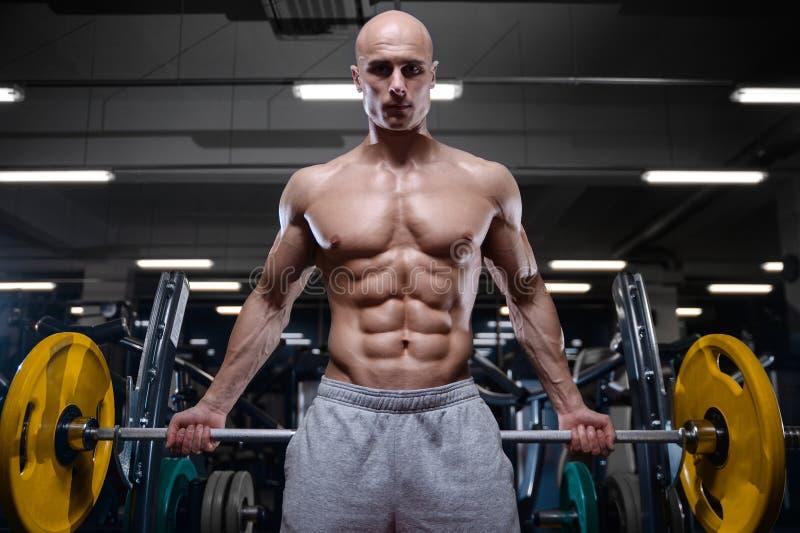 Βάναυσα ισχυρά αθλητικά άτομα bodybuilder που αντλούν επάνω τους μυς με το δ στοκ εικόνες με δικαίωμα ελεύθερης χρήσης