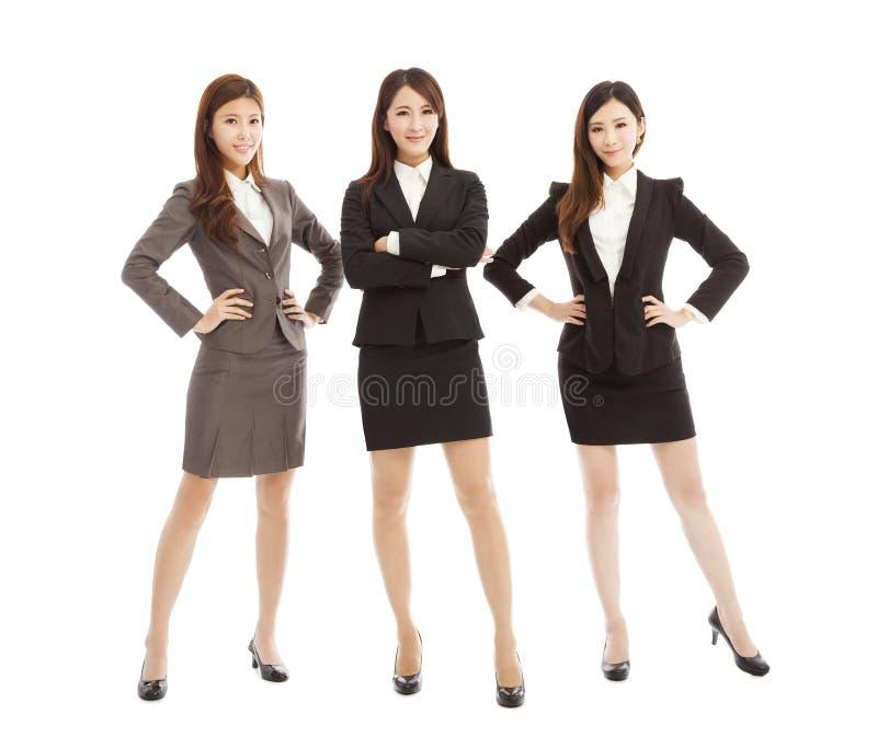 Βέβαια νέα στάση ομάδων επιχειρησιακών γυναικών που απομονώνεται στο λευκό στοκ εικόνες