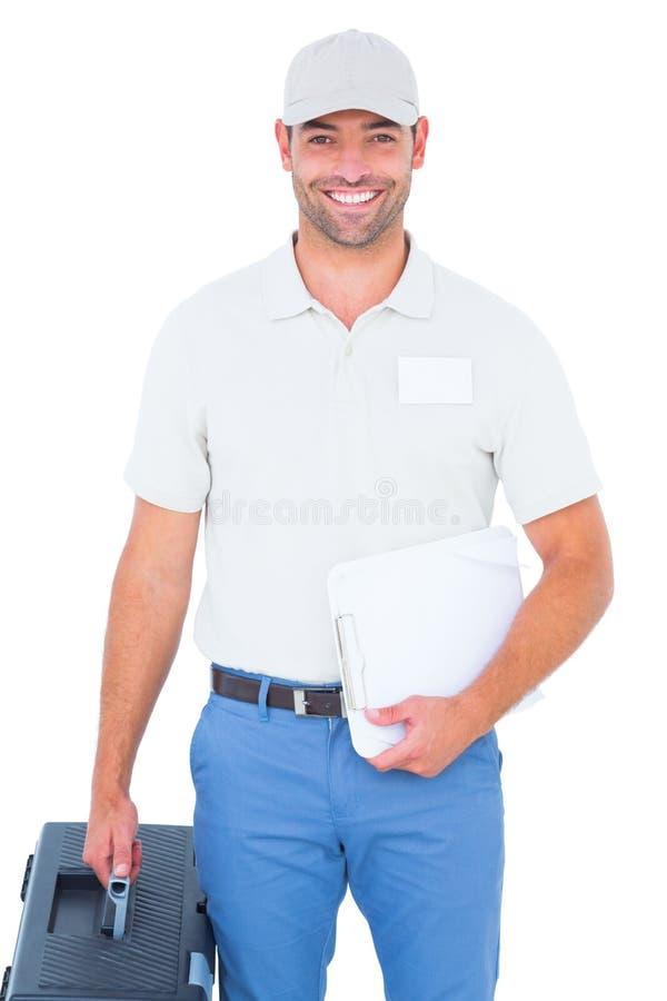 Βέβαιος αρσενικός τεχνικός με την εργαλειοθήκη και την περιοχή αποκομμάτων στοκ φωτογραφία με δικαίωμα ελεύθερης χρήσης