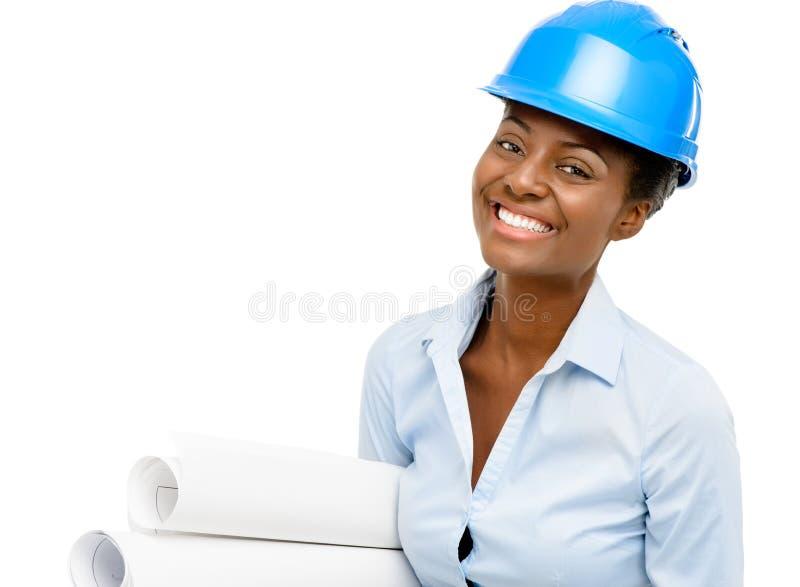 Βέβαιος αρχιτέκτονας γυναικών αφροαμερικάνων που χαμογελά το άσπρο backgro στοκ εικόνα