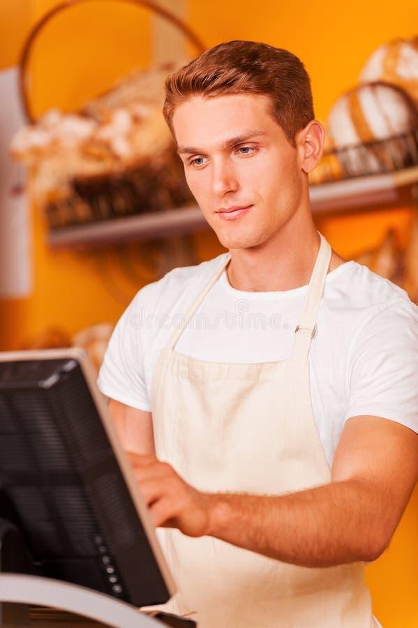 Βέβαιος ταμίας στην εργασία στοκ εικόνα με δικαίωμα ελεύθερης χρήσης