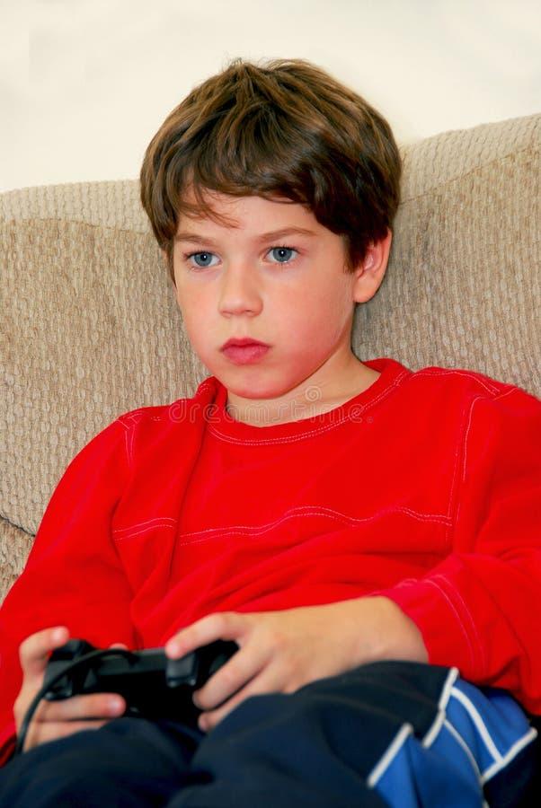 βίντεο παιχνιδιών αγοριών στοκ εικόνα