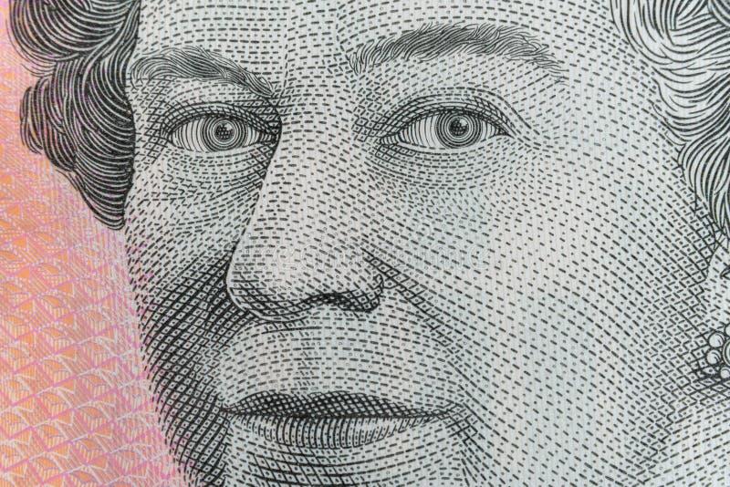 Βασίλισσα Elizabeth ΙΙ υπερβολικός μακρο πυροβολισμός ματιών στο αυστραλιανό τραπεζογραμμάτιο πέντε δολαρίων στοκ εικόνες