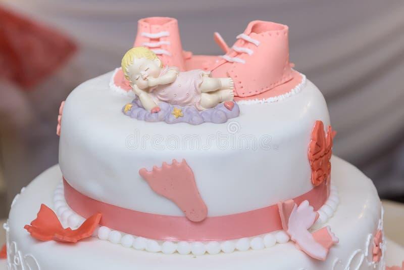 Βαφτίστε το κέικ με τα παπούτσια ζάχαρης στοκ φωτογραφίες