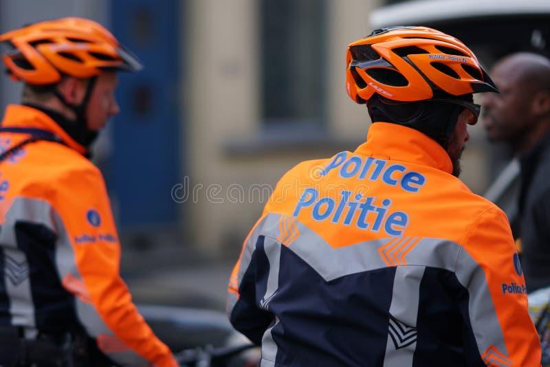 Βελγικοί αστυνομικοί στα ποδήλατα στοκ φωτογραφίες