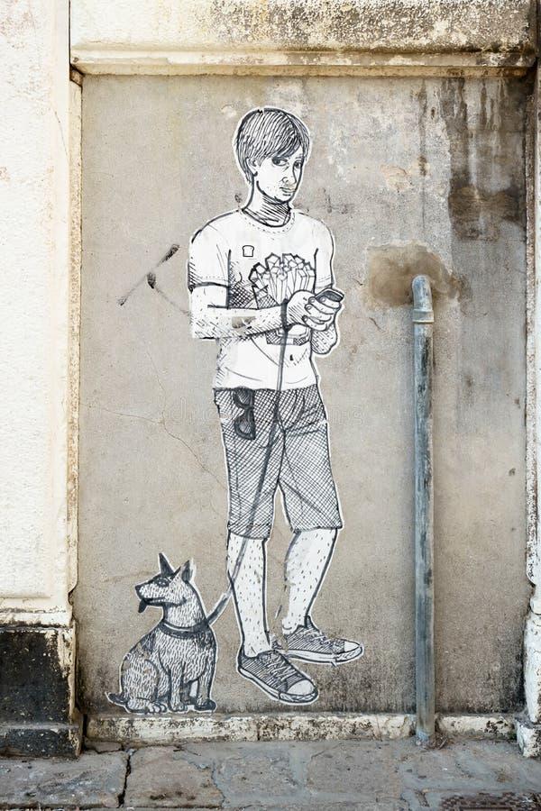 ΒΕΝΕΤΙΑ, ITALY/EUROPE - 12 ΟΚΤΩΒΡΊΟΥ: Ζωγραφική του αγοριού και του σκυλιού στο α στοκ φωτογραφία