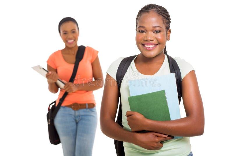 Βιβλία εκμετάλλευσης φοιτητών πανεπιστημίου στοκ φωτογραφία με δικαίωμα ελεύθερης χρήσης