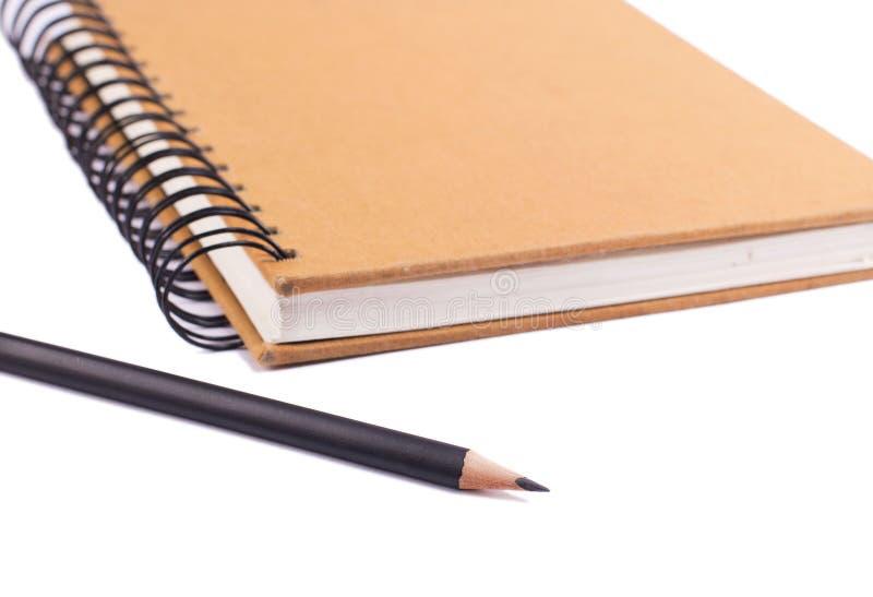 Βιβλίο και μολύβι στοκ εικόνες με δικαίωμα ελεύθερης χρήσης