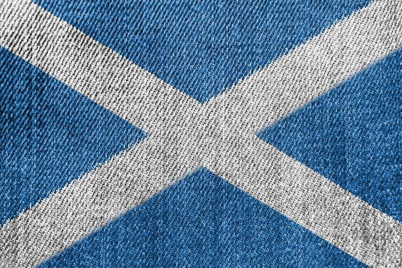Βιομηχανία κλωστοϋφαντουργίας της Σκωτίας ή έννοια πολιτικής: Σκωτσέζικα τζιν τζιν σημαιών στοκ εικόνα