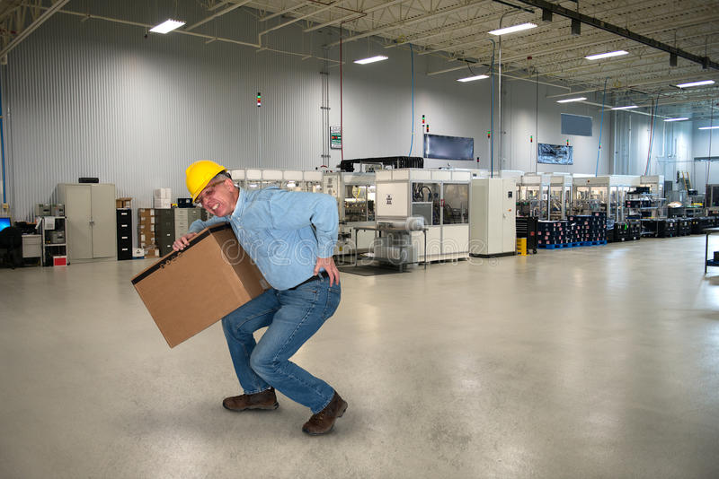Βιομηχανικός εργάτης, τραυματισμός στην πλάτη, ασφάλεια στοκ εικόνες