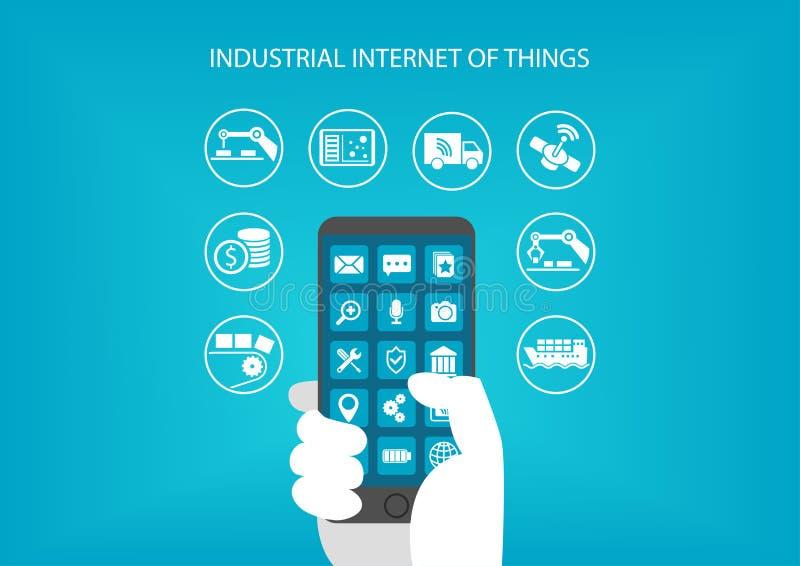 Βιομηχανικό Διαδίκτυο της έννοιας πραγμάτων Χέρι που κρατά τη σύγχρονη κινητή συσκευή όπως το έξυπνο τηλέφωνο απεικόνιση αποθεμάτων