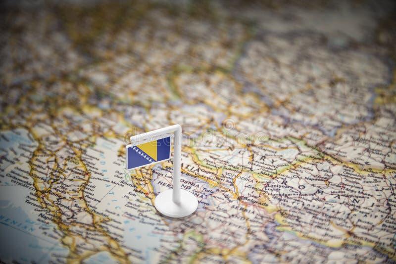 Βοσνία-Ερζεγοβίνη εμαρκάρισε με μια σημαία στο χάρτη στοκ φωτογραφία