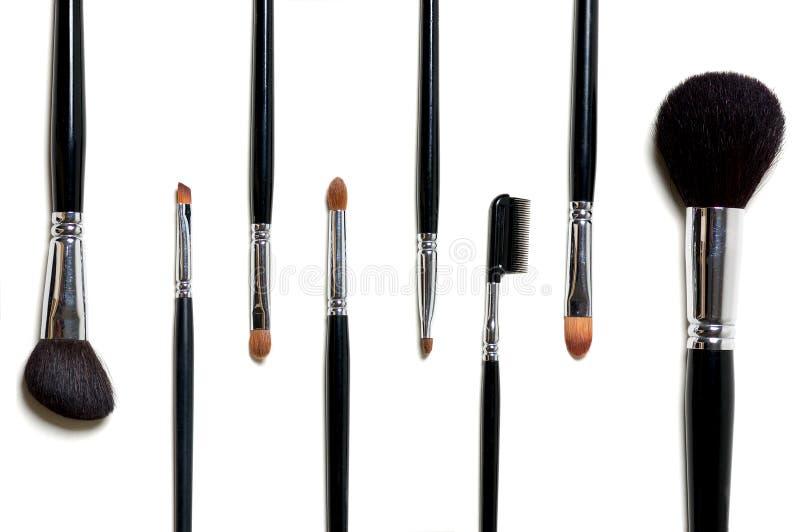 βουρτσίζει makeup στοκ εικόνες