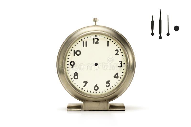 Βουρτσισμένο ρολόι συναγερμών μετάλλων στο λευκό στοκ εικόνες