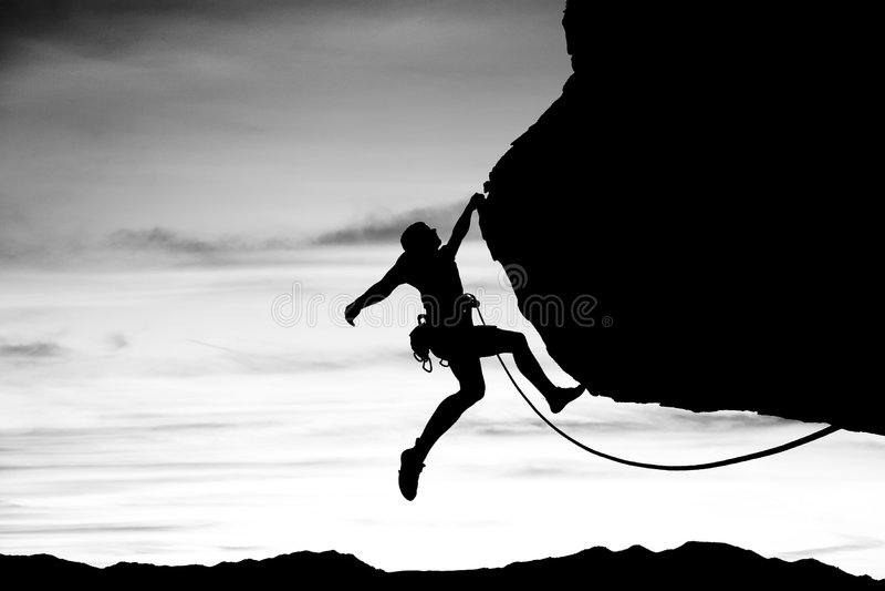βράχος ορειβατών που σκ&iot στοκ φωτογραφία