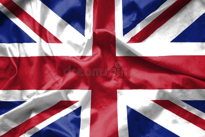 Βρετανικό υπόβαθρο βρετανικών σημαιών που κυματίζει με τη σύσταση υφάσματος στοκ φωτογραφία με δικαίωμα ελεύθερης χρήσης