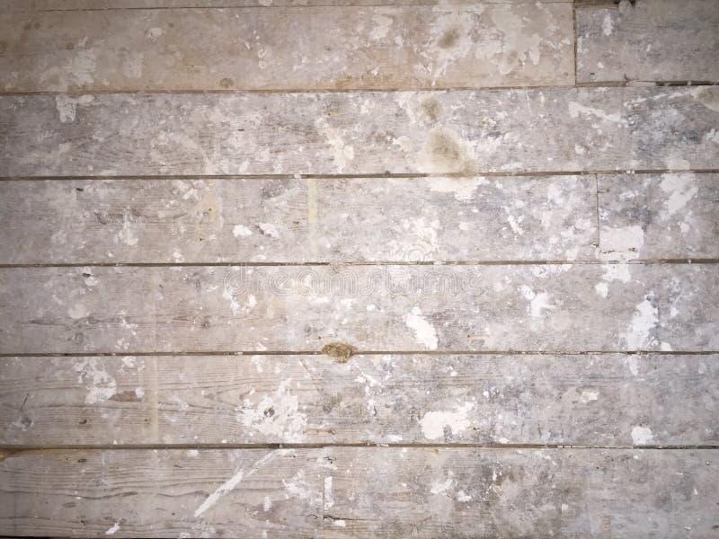 Βρώμικα καλυμμένα ασβεστοκονίαμα floorboards στοκ εικόνα