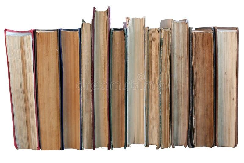 Βρώμικα παλαιά φορεμένα βιβλία, υπόβαθρο, απομόνωση σε ένα λευκό στοκ εικόνα