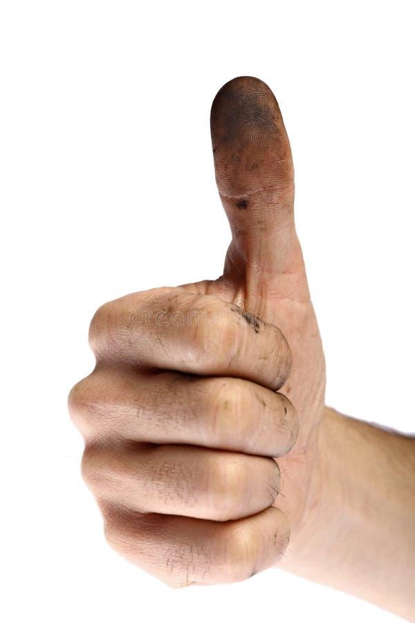 Βρώμικο χέρι με τους αντίχειρες επάνω στοκ εικόνες