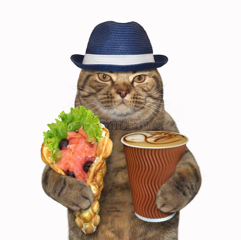 Γάτα με τις βάφλες και τον καφέ φυσαλίδων στοκ φωτογραφίες