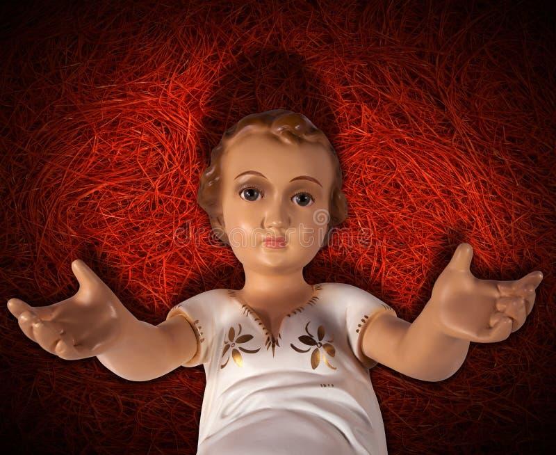 Γέννηση του μωρού Ιησούς στο κόκκινο άχυρο στοκ εικόνα με δικαίωμα ελεύθερης χρήσης