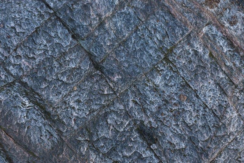Γαλαζωπή δομή πετρών με τα πλακάκια όπως χωρισμένο γρανίτη στοκ φωτογραφία