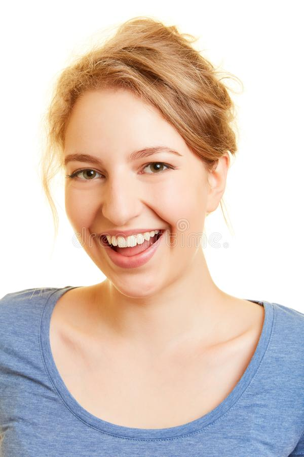 Γελώντας νέα γυναίκα με το ανοικτό στόμα στοκ εικόνα