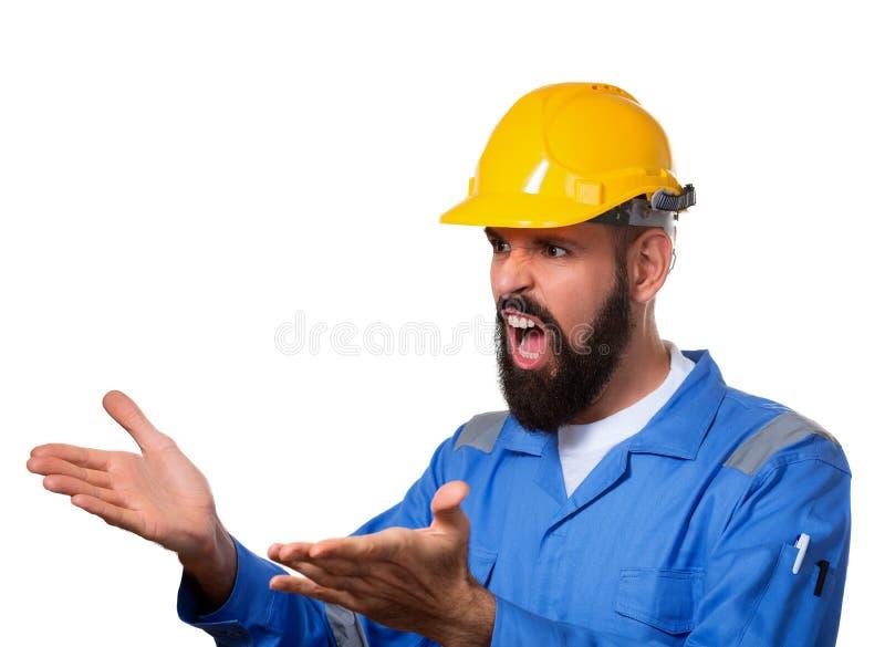 Γενειοφόρος οικοδόμος Screamimg στο σκληρό καπέλο ή στο κράνος Πορτρέτο του δυστυχισμένου οικοδόμου αρχιτεκτόνων με τους ανοικτού στοκ εικόνες
