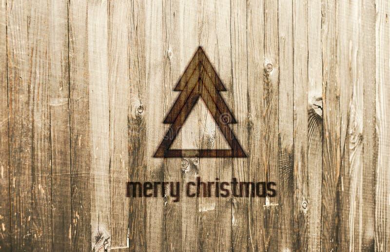 Γεωμετρικό χριστουγεννιάτικο δέντρο που καίγεται στο ξύλο εύθυμο κείμενο Χριστουγέννων καρτών στοκ εικόνες