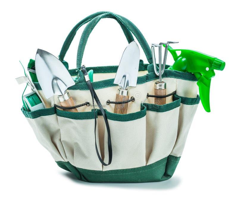 Γεωργική τσάντα με τα εργαλεία κήπων που απομονώνονται στο λευκό στοκ φωτογραφία με δικαίωμα ελεύθερης χρήσης