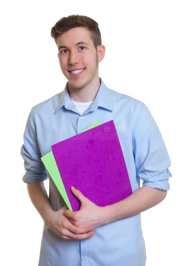 Γελώντας αυστραλιανός σπουδαστής με τη γραφική εργασία στοκ εικόνα