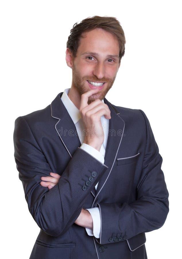 Γελώντας γερμανικός επιχειρηματίας με το σκοτάδι στοκ εικόνα