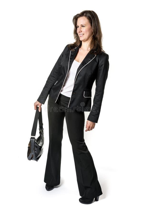 Γελώντας μόνιμη επιχειρησιακή γυναίκα στοκ εικόνα