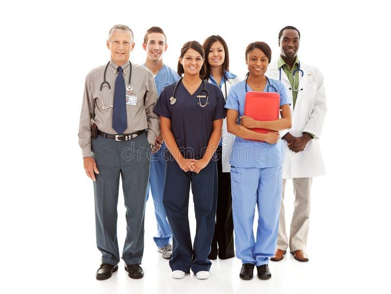Γιατροί: Εύθυμη ομάδα παθολόγων και νοσοκόμων στοκ φωτογραφία
