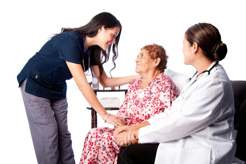 Γιατρός και νοσοκόμα που συμβουλεύονται τον ανώτερο ασθενή στοκ φωτογραφίες