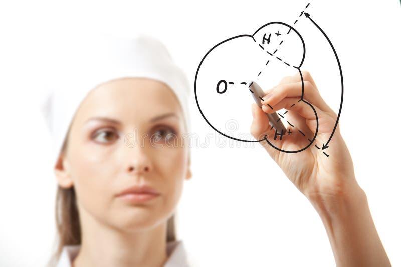 Γιατρός που γράφει κάτι με το δείκτη στο γυαλί στοκ φωτογραφία με δικαίωμα ελεύθερης χρήσης