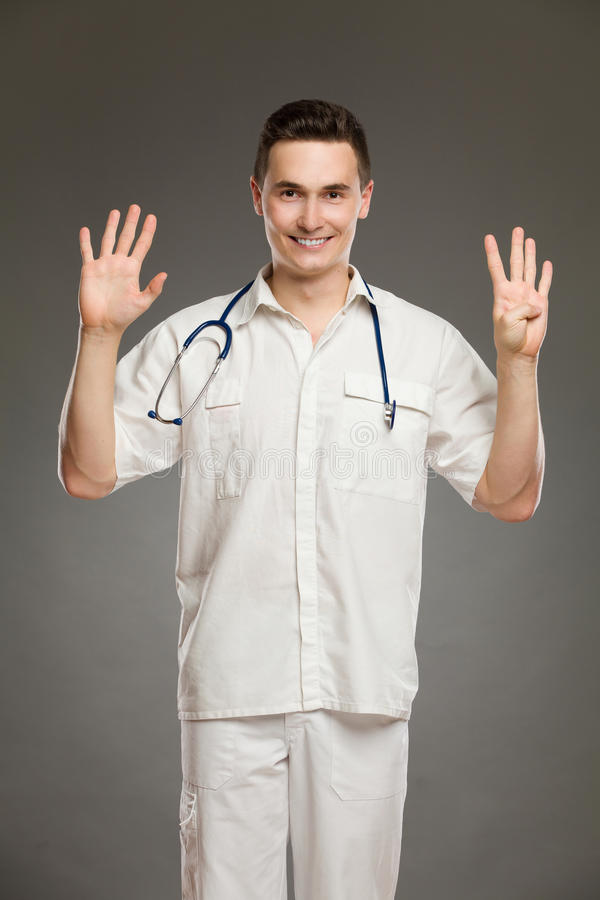Γιατρός που παρουσιάζει αριθμό εννέα στοκ εικόνες με δικαίωμα ελεύθερης χρήσης