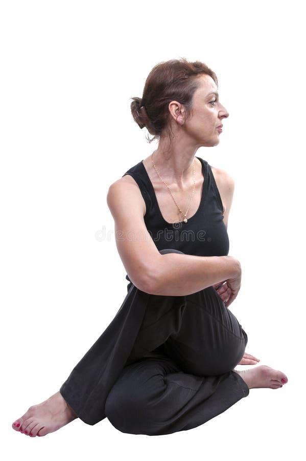 Γιόγκα άσκησης γυναικών στοκ εικόνες