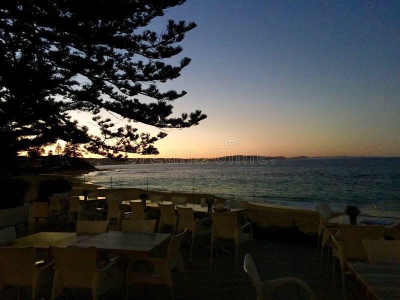 Γκολφ κλαμπ ηλιοβασιλέματος παραλιών στοκ εικόνα με δικαίωμα ελεύθερης χρήσης