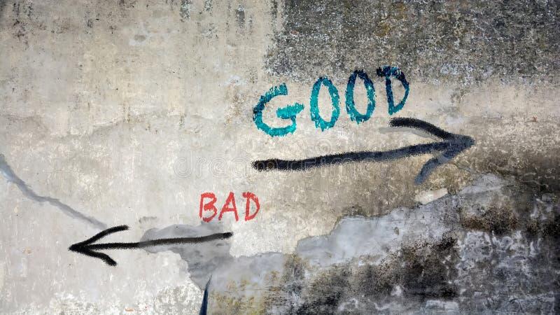 Γκράφιτι τοίχων καλός εναντίον κακός στοκ φωτογραφία με δικαίωμα ελεύθερης χρήσης