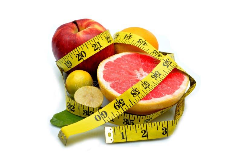 Download Γκρέιπφρουτ και άλλα φρούτα με την ταινία μέτρου γύρω Στοκ Εικόνες - εικόνα από τρόφιμα, λεμόνια: 62701570