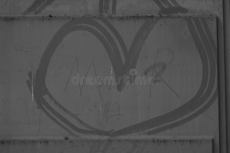 Γκρίζα διαμορφωμένη καρδιά φωτογραφία υποβάθρου ενός κτηρίου όπως τη σύσταση στοκ εικόνες