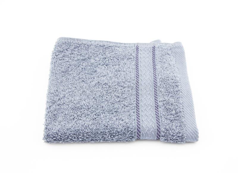 Γκρίζα πετσέτα πλακών στο άσπρο υπόβαθρο στοκ εικόνα με δικαίωμα ελεύθερης χρήσης
