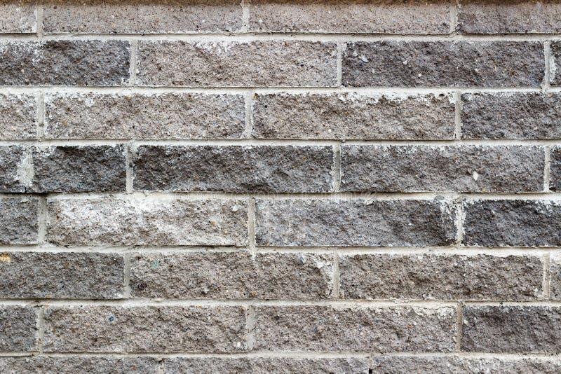 Γκρίζα σύσταση τοίχων τούβλων πετρών Αφηρημένο υπόβαθρο τούβλου πετρών στοκ φωτογραφία με δικαίωμα ελεύθερης χρήσης