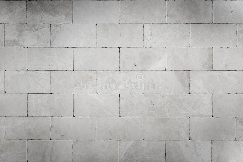 Γκρίζα υπόβαθρα τοίχων πετρών στοκ εικόνα