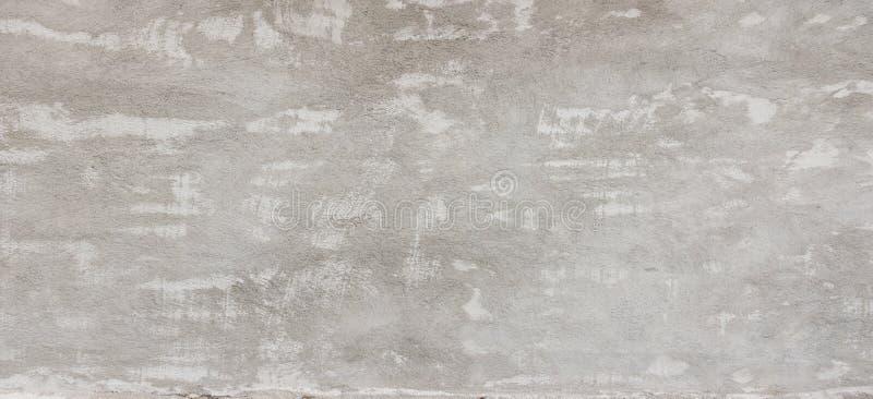 Γκρίζο έμβλημα υποβάθρου τοίχων ασβεστοκονιάματος grunge στοκ φωτογραφία